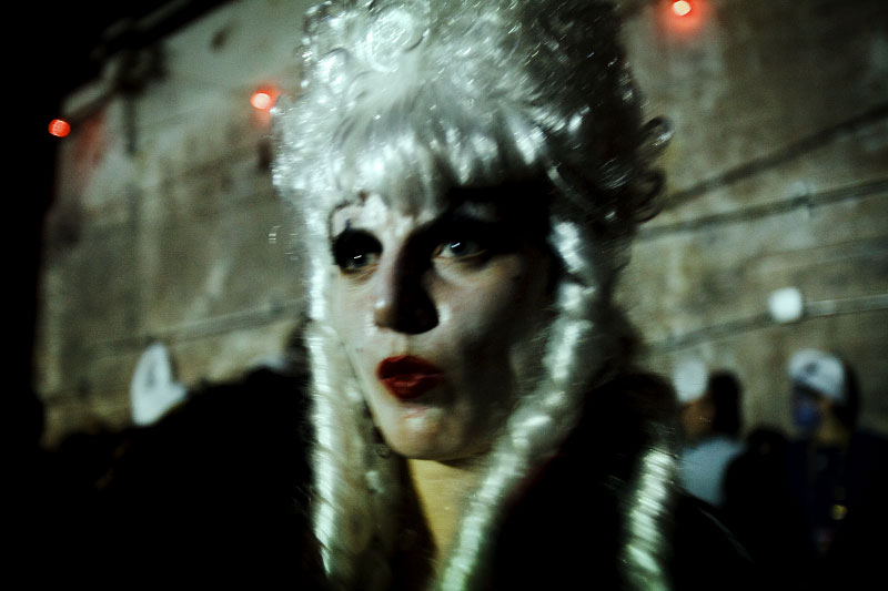 A scene of the classic deep-Brooklyn party in a massive 112 year old warehouse done by the Promise land. Halloween in New York City is that intoxicating mix of hedonism spiked with ritual that turns the night into carnival and the street into a stage.
