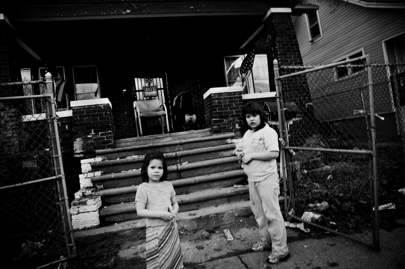Detroit children hang out in the neighborhood where abandoned or empty houses are quite often seen.