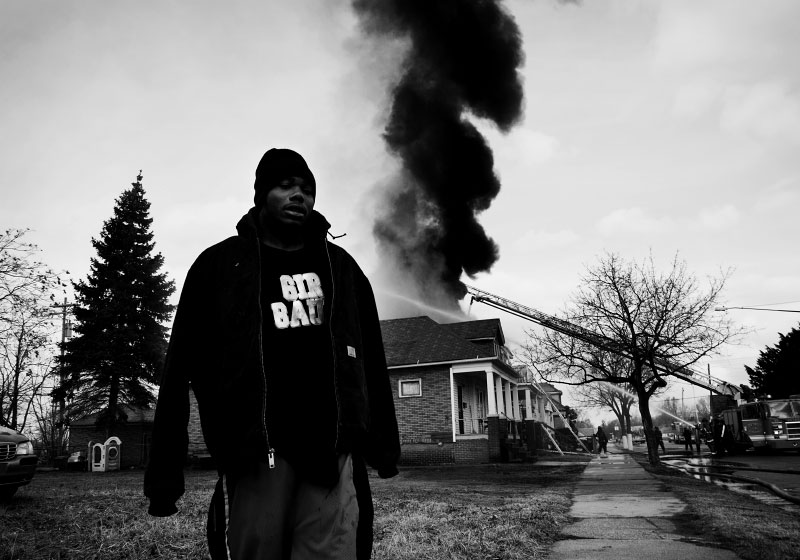 A community resident walks away from a fire scene of an abandoned house in East Detroit, where many abandoned or foreclosed houses exist, and often get burned down or fired by arson or drug addict squatter's unconscious acts. The case of this house fire is said probably the latter cause, according to the neighbors. Whether it is an arson or a neglected cause, the fire on abandoned houses is getting one of the most critical issues in Detroit.