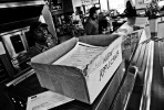 A box fully with new applicants' job application forms is put at a counter in a franchised fast food restaurant, as the unemployment rate is very high in Detroit.