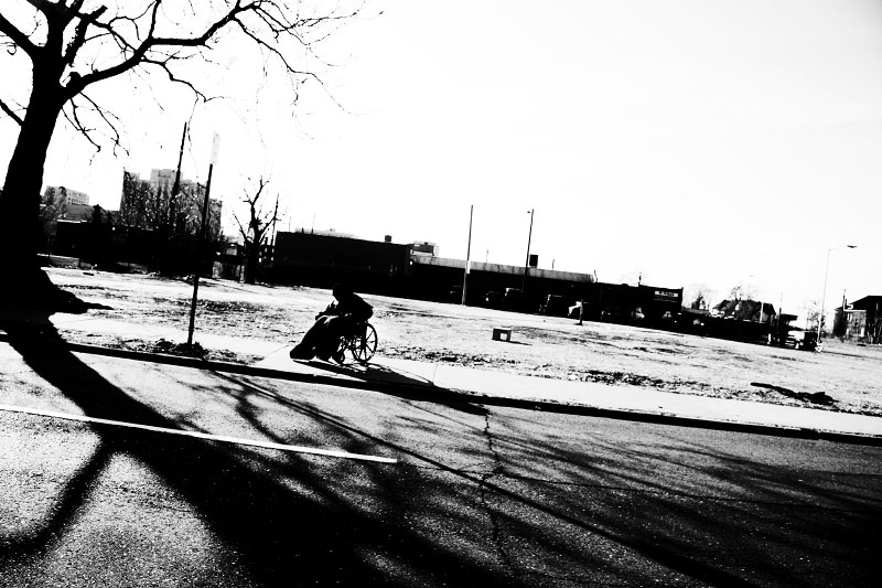 Handicapped homeless man Keefe Lancaster, 53, hangs out near a shelter, before he goes to the central area of Detroit to beg money. Yet, the trip is hard. He has to push his wheel-chair for hours and the earning is $ 10 to $20 a day.