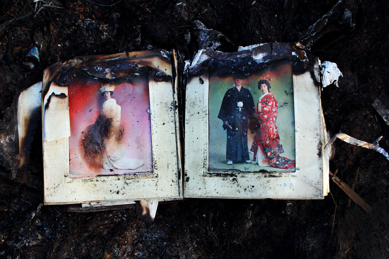 A burned out wedding album remains at a tsunami destroyed and burned down area in Kesennuma, Miyagi, where many people in the cars and ships were washed out and trapped and killed due to the tsunami. And survivors could hear the crying all the night.