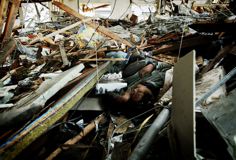 A body remains at the debris of an office in Shiraishi district of Otsuchi, Iwate, Japan.