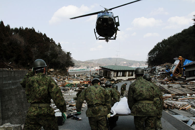 In Otsuchi, Iwate, Japanese Army carry out a body, a monster tsunami victim, to a helicopter.