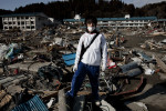 18 year old Tsunami survivor Kouji Sugan, who just graduated from high school, stands in front of the tsunami destroyed school, as he checks around the community of Rikuzen-Takada, and as he often has nightmare of the day of the tsunami hit.