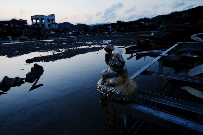 The destroyed scene of Minami-Sanriku, Miyagi, due to the unprecedented tsunami in Japan. The statue of Daikokuten, a Japanese god for bless and prosperity was put at this site by someone, probably praying for rebuilding.