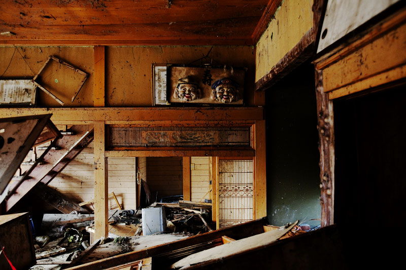 Two masks of Ebisu, a Japanese god for economic prosperity, remain at the tsunami destroyed house in Onagawa, Miyagi.