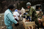 Japanese  Army distribute preserved packs of noodle to residents at a tsunami affected area in Otsuchi, as also suffer with the lack of food and water, but they can only get 5 packs of noodle a person per week, since the distribution is very scarce, like this image.