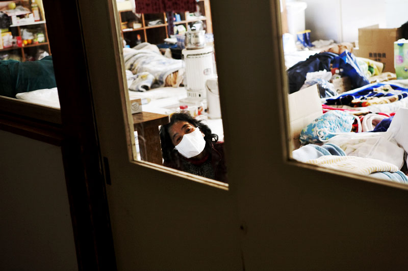 A female tsunami survivor stays at a classroom of an elementary school which is used as an evacuation center in Otsuchi.