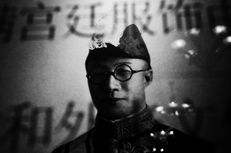 A photograph of China's last or Qing and then Manchukuo emperor Puyi hangs at the former Imperial Palace of Manchukuo, or the Manchu State, where he stayed as Japanese puppet from 1932 to 1945.
