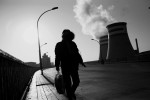 A woman walks near coal burning power plants in Jixi, a coal industrial town, near the Russian border. Coal is still a primary source for power, heating and cooking fuel in China, despite the environmental health hazards.
