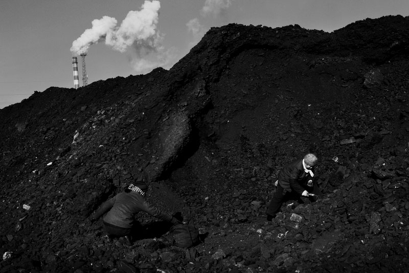 Women scavenge useable coals from a slag heap near a factory in Jixi to make home warm, in the frigid temperature - nearly minus 20 C or minus 4 F, as many of the remote areas, like this town of Jixi, in China's North East remain in poverty, despite China's miracle economic growth for the last decade. And Coal is still a primary source for power, heating and cooking fuel in China, despite the environmental health hazards.