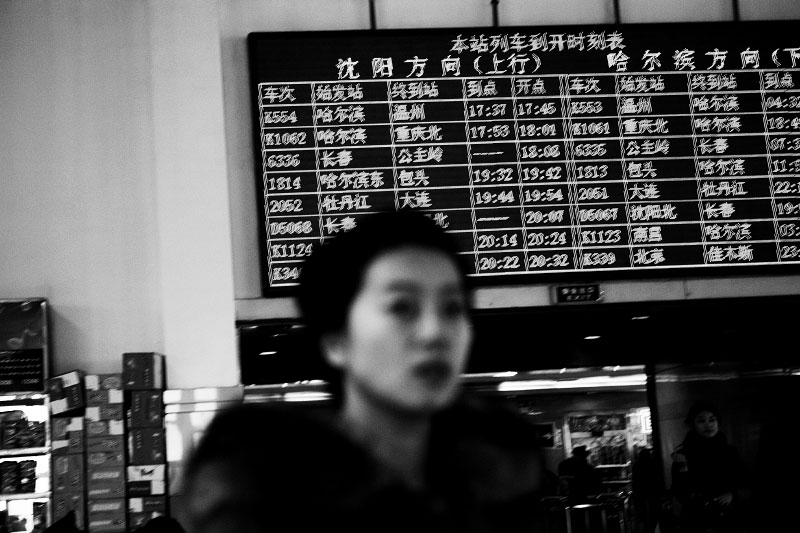 A woman at Changchun railway station that once attracted the foreign interests of Japan and Russia with creating bloody conflict in Manchuria. Railway in China is now a primary transportation source for far trips.