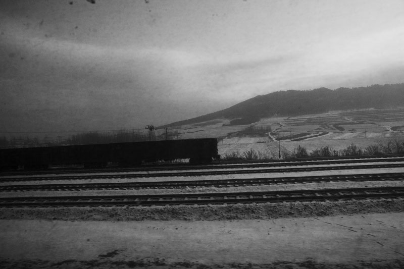 A scene from a train in Heilongjiang Province in  China's North East that was once the severe battlegrounds of Russia, Japan, and China from the early to the mid 20th century. Then railway system was a big interest of foreign states of Russia and Japan and other power states. And it is now a primary transportation source for far trips in China.