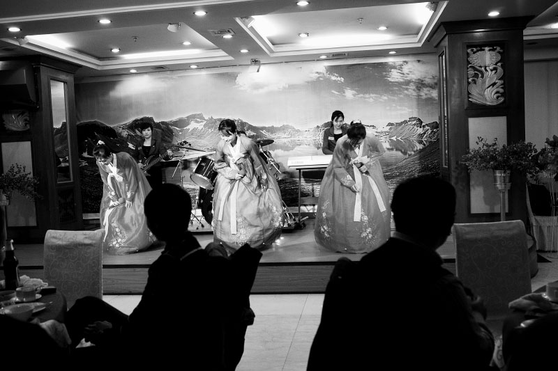 North Korean women bow after the singing and dancing at an expensive North Korean restaurant in Shen Yang in China's North East. Some part of Manchuria were once Goguryeo,an ancient Korean kingdom, due to the reason there are many Koreans Chinese or Korean tribes in the Chinese term, and now many Koreans from North Korea come to work in this region to help their families and fellows in the country.