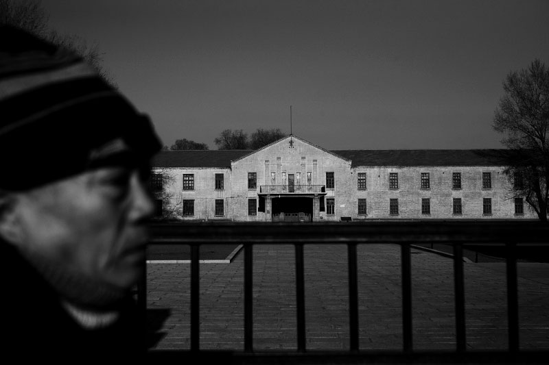 A man stands in front of the former and preserved complex of the Unit 731 -- a covert biological and chemical warfare research and development unit of the Imperial Japanese Army that allegedly undertook lethal human experimentation during the Second Sino-Japanese War (1937–1945) and World War II. Harbin, China's North East.