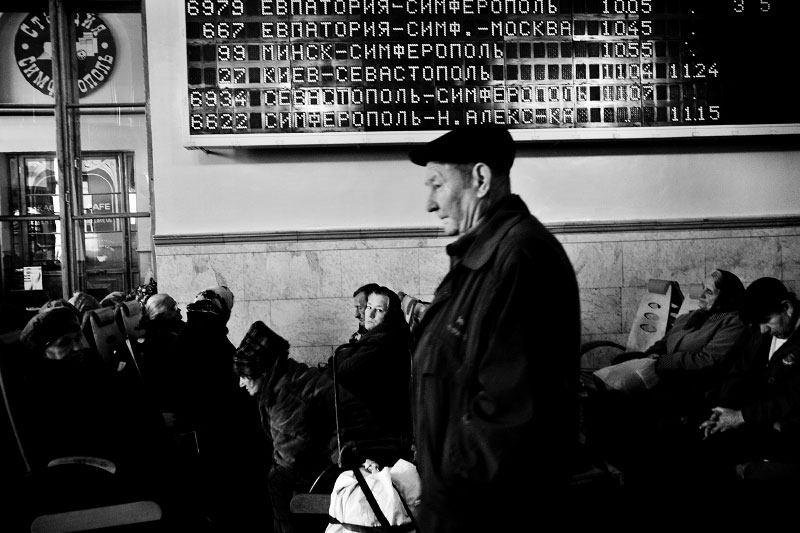 At a waiting room at Simferopol station in Crimea, poor people, often including the homeless, stay to warm up. Although middle class starts to emerge in Crimea and other parts of Ukraine, still many are struggling for their life, and such reality often becomes one of strong reasons to create pro-Russian tendency. Crimea is an autonomous republic of Ukraine, located in the south of the country on the Black Sea, and the majority is absolutely Russians. Russia has kept remaining the Black Sea Fleet in Sevastopol for over 200 years, even after Ukraine's 1991 independence. Although the fleet remaining is due to the two country's agreement, because of the status, Crimea has become one of the Russia-related potential flashpoints. Nov 14 2008.