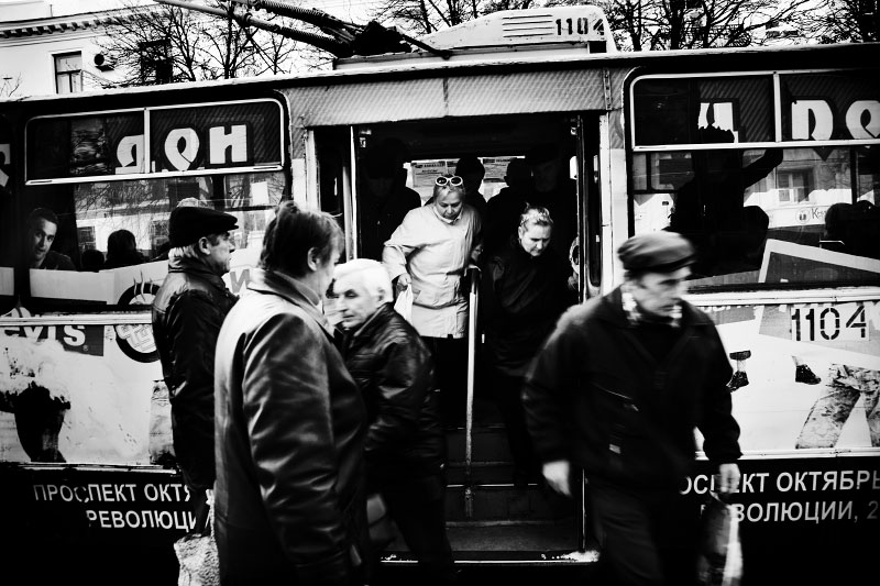 People are getting off a trolley car in Sevastopol. Most Crimean transportation depend on slow trolley cars. It may very hard to develop a new transportation system soon as Ukraine faces economic crisis. Although middle class starts to emerge in Crimea and other parts of Ukraine, still many are struggling for their life, and such reality often becomes one of strong reasons to create pro-Russian tendency. Crimea is an autonomous republic of Ukraine, located in the south of the country on the Black Sea, and the majority is absolutely Russians. Russia has kept remaining the Black Sea Fleet in Sevastopol for over 200 years, even after Ukraine's 1991 independence. Although the fleet remaining is due to the two country's agreement, because of the status, Crimea has become one of the Russia-related potential flashpoints. Nov 18 2008.