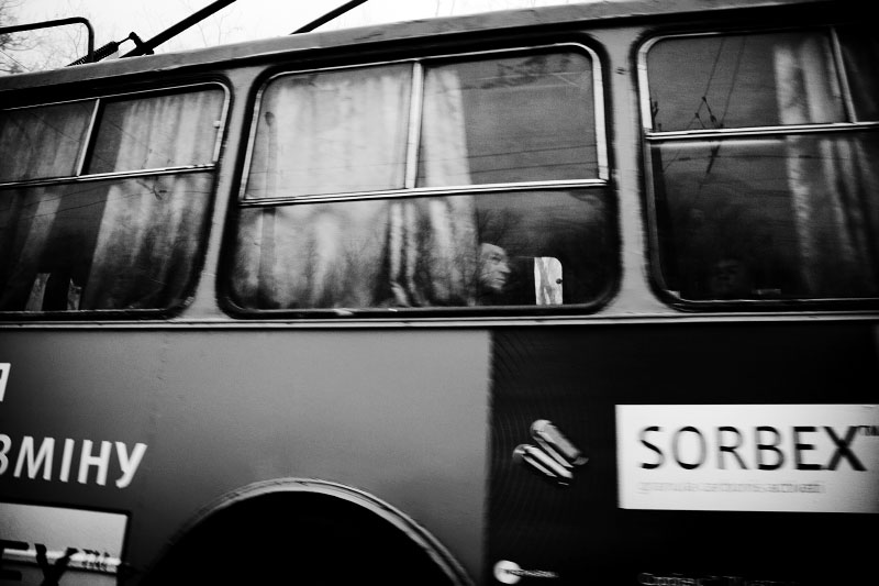 Men are seen through a window of a trolley car. Most Crimean transportation depend on slow trolley cars. It may very hard to develop a new transportation system soon as Ukraine faces economic crisis. Although middle class starts to emerge in Crimea and other parts of Ukraine, still many are struggling for their life, and such reality often becomes one of strong reasons to create pro-Russian tendency. Crimea is an autonomous republic of Ukraine, located in the south of the country on the Black Sea, and the majority is absolutely Russians. Russia has kept remaining the Black Sea Fleet in Sevastopol for over 200 years, even after Ukraine's 1991 independence. Although the fleet remaining is due to the two country's agreement, because of the status, Crimea has become one of the Russia-related potential flashpoints. Nov 15 2008.