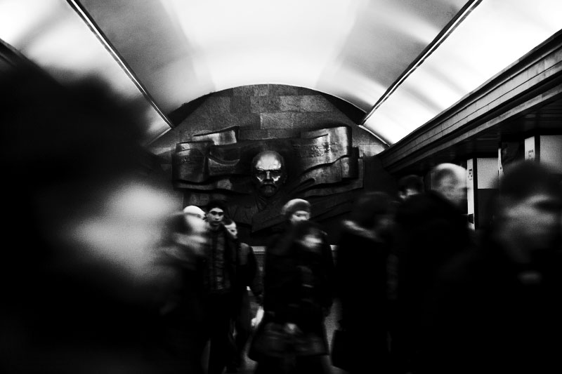 People commute at a Metro station in Kiev, while a face of Lenin looks on them. After Russia-Georgian war in summer, and as Ukraine starts to face the economic crisis, many people of the country, not only in Crimea, are looking more toward Russia; or at least the Orange revolution might be in crisis. Nov 28 2008.