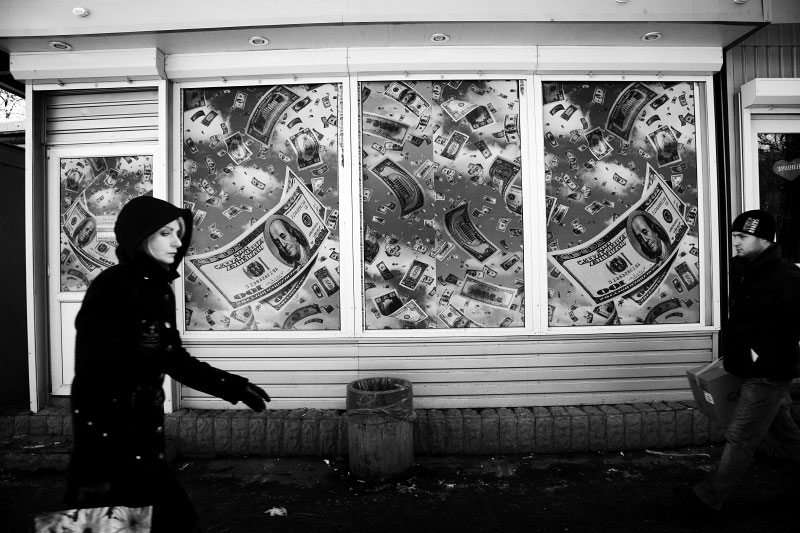 People in Kiev walk by a promotion ad of a Casino, as the economic crisis has started to hit Ukraine. Kiev. Nov 24 2008.