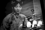 With the chandelier reflection, a photograph of Lady Gobulo (Empress Xiaokemin) remains at the former Imperial Palace of Manchukuo, or the Manchu State, where her husband, Manchukuo emperor Puyi, or China's last emperor of the Qing dynasty before the throne, stayed as Japanese puppet from 1932 to 1945. Changchun, Jilin province, China's North East.China's North East was once called Manchuria. The region was at a crossroads that was manipulated in history, including the occupation by Russia and Japan. And now the area is facing upheavals due to the globalization with China's rapid economic growth itself, creating the gap between the rich and the poor and even more unemployment.