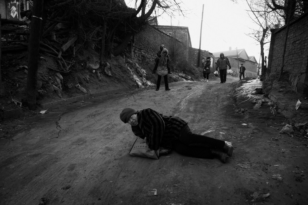 In the frigid remote town of Jixi, Heilongjiang Province, in China's North East, in the temperature of minus 20 C or minus 4 F or so, a woman slipped down, hurting severely, since the unsealed downhill street was frozen.China's North East was once called Manchuria. The region was at a crossroads that was manipulated in history, including the occupation by Russia and Japan. And now the area is facing upheavals due to the globalization with China's rapid economic growth itself, creating the gap between the rich and the poor and even more unemployment.