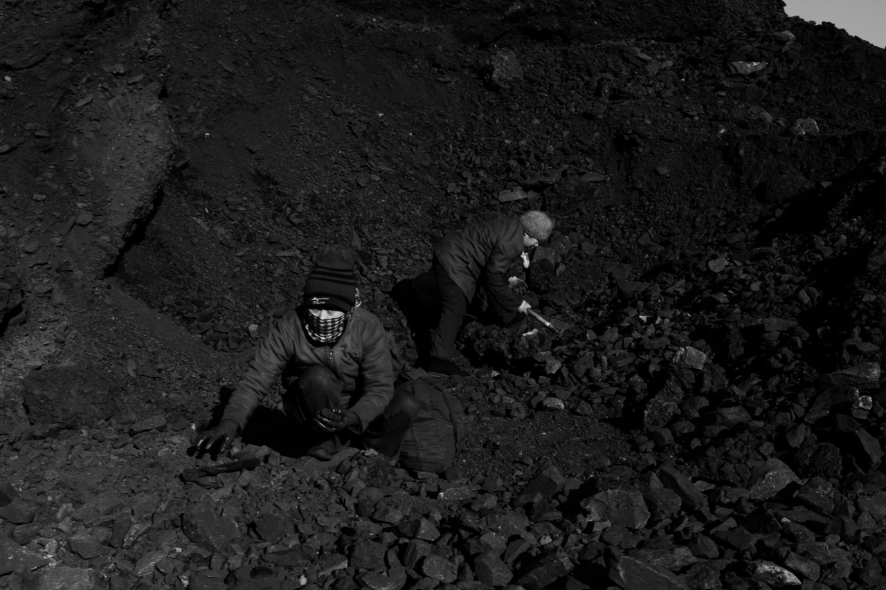 Women scavenge useable coals from a slag heap near a factory in Jixi to make home warm, in the frigid temperature - nearly minus 20 C or minus 4 F. Many of the remote areas, like Jixi in China's North East, remain in poverty, despite China's miracle economic growth for more than decades. Coal is still a primary source for power, heating and cooking fuel in China, despite the environmental health hazards.China's North East was once called Manchuria. The region was at a crossroads that was manipulated in history, including the occupation by Russia and Japan. And now the area is facing upheavals due to the globalization with China's rapid economic growth itself, creating the gap between the rich and the poor and even more unemployment.