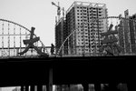 Hight rise residential buildings are constructed and a man walks on a highway bridge, Shen Yang, Liaoning province, in China's North East. In 1931, near the site, Kantogun, part of then Imperial Japanese Army, set up the railroad bombing, called as Liutiaohu Incident, or the September 18 Incident in the Chinese term. Desptie the fact it was a plot by Kantogun Army itself, it became a pretext of Japna's furterh invasion to China and of consequently creating Machu State, Japan's puppet state. China's North East was once called Manchuria. The region was at a crossroads that was manipulated in history, including the occupation by Russia and Japan. And now the area is facing upheavals due to the globalization with China's rapid economic growth itself, creating the gap between the rich and the poor and even more unemployment.