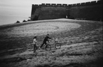 A couple, with a bicycle, walks near Lao Long Tou, or Old Dragon's Head, in Shanhaiguan that had experienced many severe fightings in the history between the Han Chinese and people from the North, such as Khitns and Manchus. Lao Long Tou is the starting point of China's famous Great Wall and at the point the wall meets the sea. The lands to the North East of the Great Wall was once called Manchuria.China's North East was once called Manchuria. The region was at a crossroads that was manipulated in history, including the occupation by Russia and Japan. And now the area is facing upheavals due to the globalization with China's rapid economic growth itself, creating the gap between the rich and the poor and even more unemployment and worrying for the future.