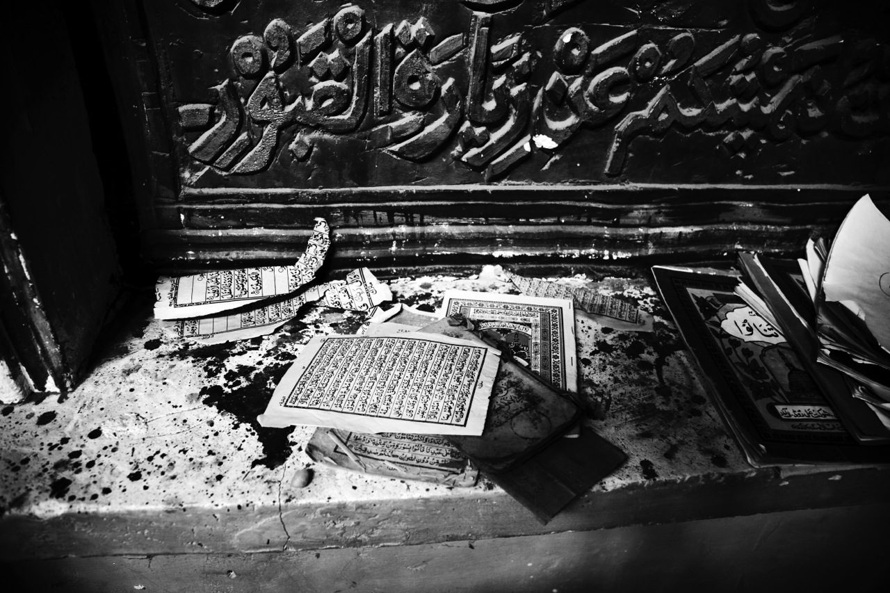 Ripped-off pages of Koran remain at a mosque at Taklamakan Desert in Xinjiang, as the Chinese government-supported development fortified with millions of ethnic Han Chinese migrants has rapidly and enormously changed the social landscape of the region.
