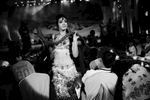 A Uighur woman performs a belly dance with a live snake in front of Han Chinese customers at a club in Urumqi. Although the dress is un-Islamic, many Uighur women, Muslims, like her, take such a performing job to make ends meet.