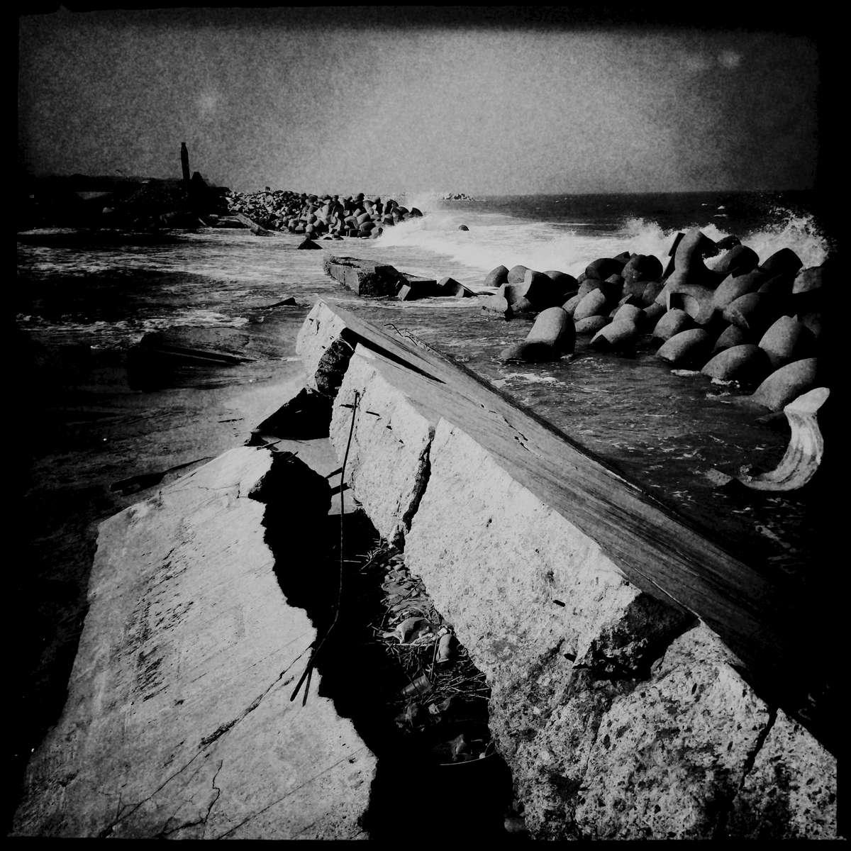 A broken seawall by tsunami, that triggered the 2011 Fukushima nuclear disaster, still remains. July/ 2014, Odaka, Minami-Soma.
