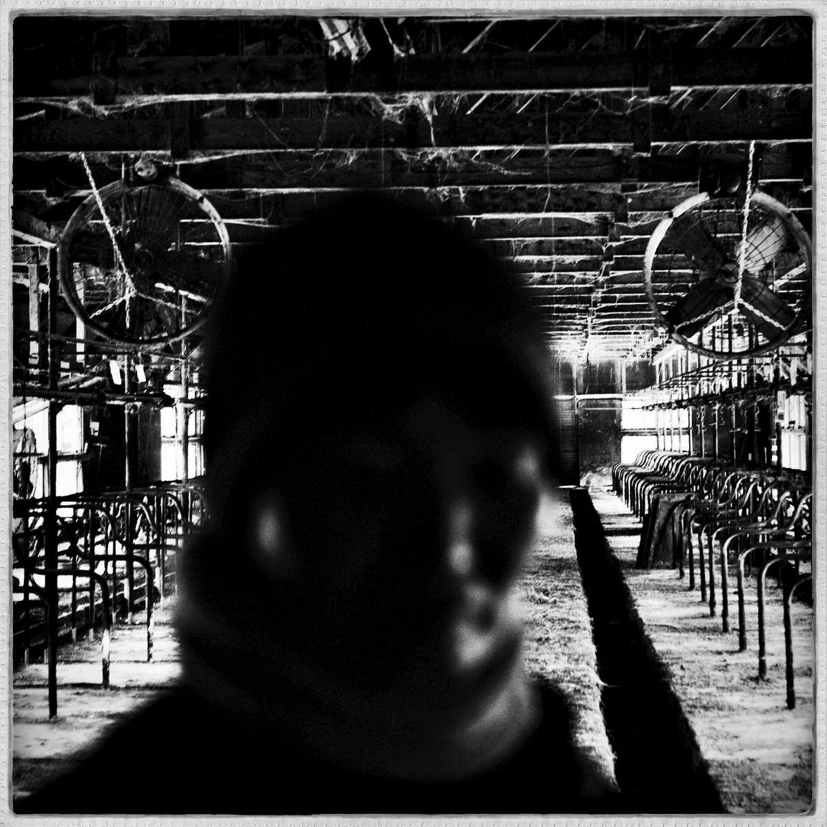 Keiko Sansei, 56, at her virtually abandoned dairy farm due to high radiation. Feb/ 2013, Tsushima, Namie.