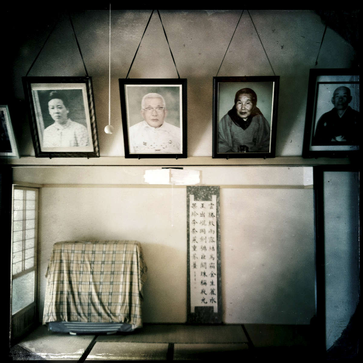 The ancestor portraits of the Sanpei family at their house, now virtually no return due to radiation. Feb/ 2013, Tsushima, Namie.