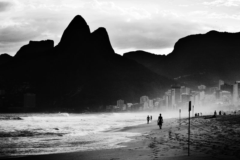 A scene of Ipanema Beach with Hill Dois Irmaos, or Mt Brothers, that separates the rich residential areas from favelas. May 2007.