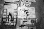 On a wall of a prison in Rio, a poster of Jesus Christ and drawings of guns stay together, as both are outstandingly high figures in the town, especially in favelas. Feb 2008.
