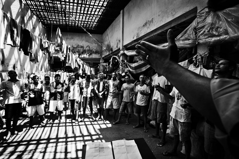 In a prison in Rio, gang inmates of Comando Vermelho join a Christian procession led by missionaries, while the prison is unhealthy and extremely crowded, and the situations are neglected by the government. Feb 2008.