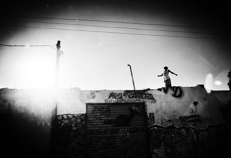 A child looks onto sky on a broken building in favela Complexo Do Aleman where poverty and unemployment are rampant, and law of violence by mafia-like gang Comando Vermelho is predominant. May 2007.