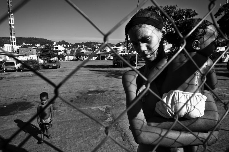 A young single mother and her children in favela Cidade Nova where poverty, unemployment and violence are rampant. May 2007.