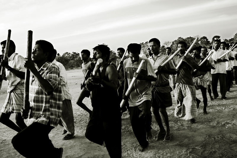 In Kilinochchi, the most stronghold of LTTE, Liberation Tigers of Tamil Eelam , Tamil civilians take military training under LTTE's command, as the fresh violence between the government and the rebel has been escalating. Although trainees use logs as guns, LTTE distributes such weapons to their homes. Also some participants come from the government controlled areas, such as capital Colombo, to join the training. Kilinochchi, Sri Lanka, June 13 2006.