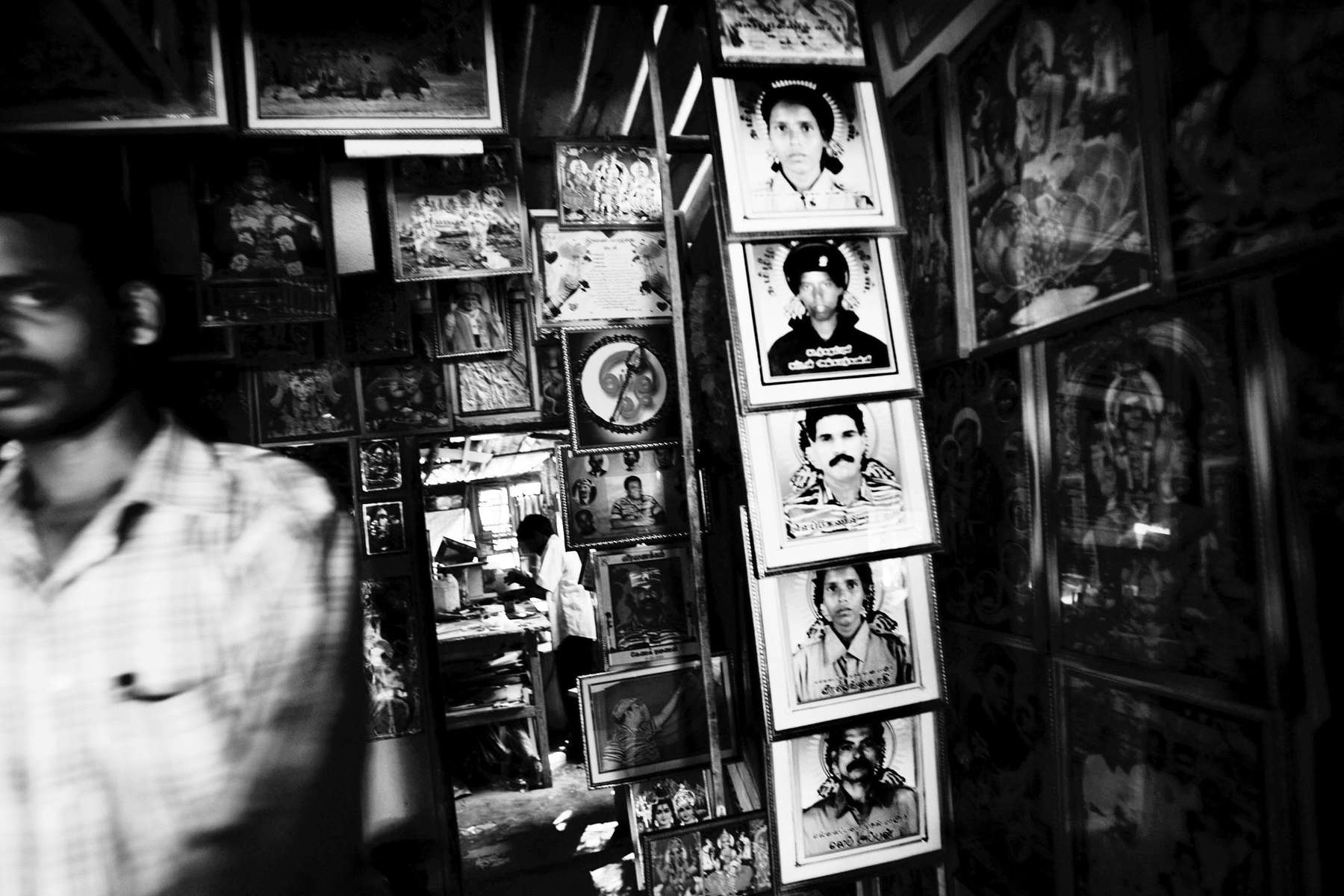 At a religious poster shop in Kilinochchi, the most stronghold of LTTE, the photos of martyrs, or suicide bombers, are also displayed. Sri Lanka, June 2006.