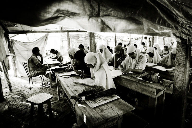 Muslim girls take the learning at a war-torn classroom in Mutur, a town of North Eastern Sri Lanka, where Tsunami destroyed it devastatingly and now the residents are facing the fresh fighting between the Sri Lankan government and LTTE rebel. Mutur, Sri Lanka, June 18, 2006.