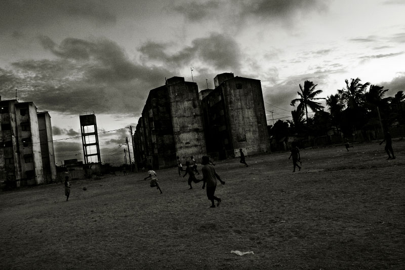 At a war-torn project in Jaffna, Tamil youths and children play football. In the town, unemployment prevails due to the long civil war and the current fresh fighting, as well as Tsunami. Many residents seek for the escape due to the fear of deadly human rights oppressions. Jaffna, Sri Lanka, June 22, 2006.