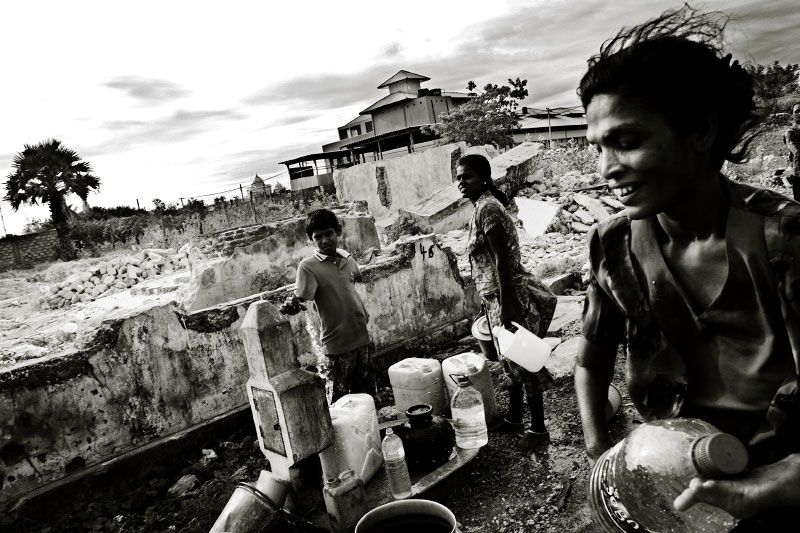 Tamils obtain water from a well in a war-torn town of Jaffna, one of the most critical places for LTTE and the Sri Lankan government – the absolute majority of the town is Tamil but controlled by the government. In Jaffna, unemployment prevails and many face extreme poverty and dangerous situations due to the long civil war and the current fresh fighting, as well as Tsunami. The political violence between the government and LTTE is escalating, and the situation just seems to be at the brink of the restart of war. Jaffna, Sri Lanka, June 23, 2006.