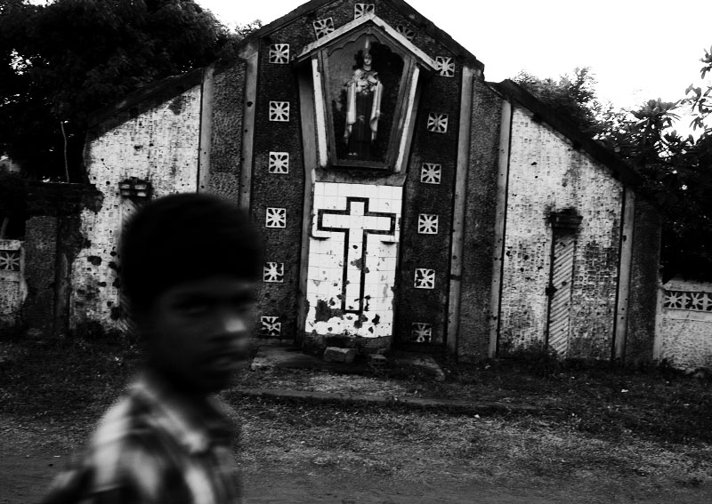 A boy walks through in front of a destroyed church in LTTE rebel's stronghold of Kilinochchi, as the long civil war and the current fresh fighting have devastated many parts of Sri Lanka. Kilinochchi, Sri Lanka, June 13, 2006.
