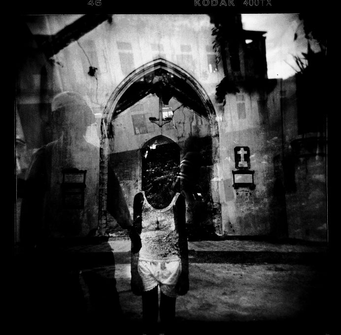 The image of a Sri Lanka government soldier is accidentally overlapped with the image of a Tamil girl staying at a war-torn church in Jaffna, where the long civil war has devastated people's life and economy and now the residents are facing the fresh fighting between the Sri Lanka government troops and LTTE rebel, despite the 2002 ceasefire. Jaffna, Sri Lanka, June 2006.