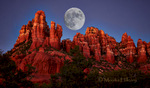 A Full Moon rising and embraced by the glowing Red Rocks of Sedona, AZ