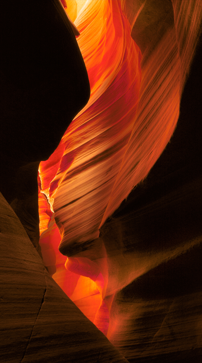 Antelope Canyon Detail of the glowing curves of carved sand stone over time.