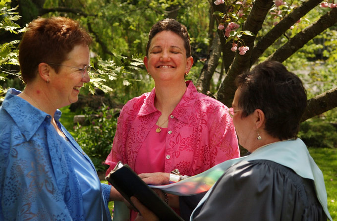 Sherry Burlingame beams as she and partner Linda Zetterberg are joined in marriage by Unitarian minister Doreen Peever in St. Catharines, Ontario. Both emerged from long marriages to men before coming out as lesbians and finding each other through an internet support group.